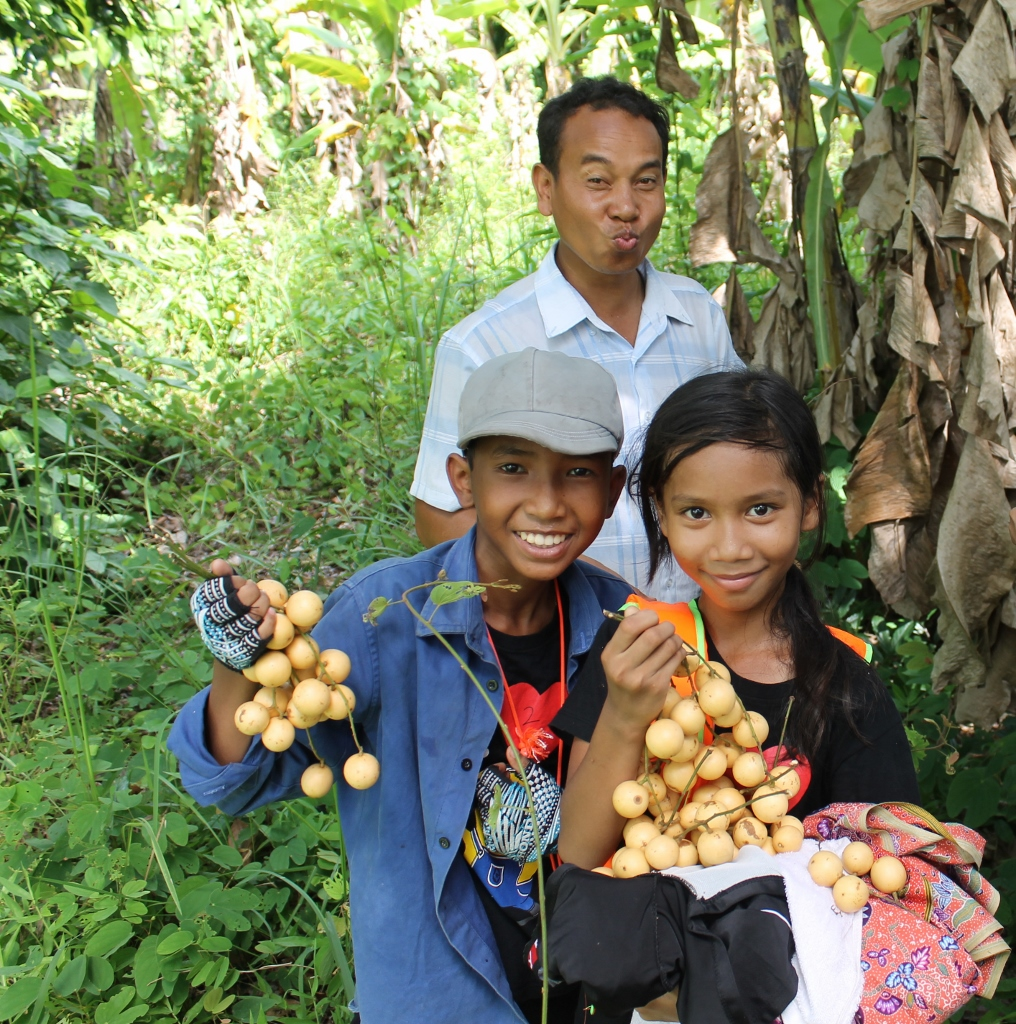 Somphors, Kanha and Sothea  holding  visitor fruit. We  picked them in the farm on our way to O'Malu waterfall. Sothea is our driver, he drove us from Phnom Penh, where our school is, to Koh Kong province.